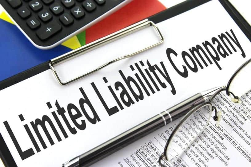 document limited liability with calculator, pen and glasses for Forming an LLC