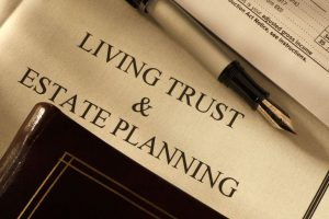 Living trust document with [en and brown book for revocable trust